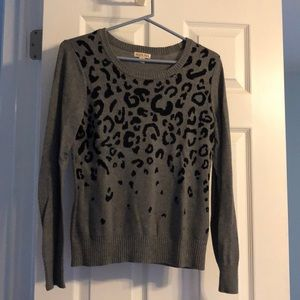 Dark grey long sleeve cheetah print sweater.